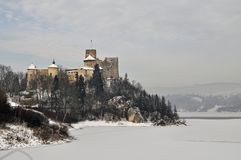 Medieaval castle in Niedzica in Poland in wintertime. Medieval stone defence castle on a hill in Niedzica in mountains in southern Poland during winter time royalty free stock photos