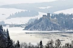 Medieaval castle in Niedzica in Poland in wintertime. Medieval stone defence castle on a hill in Niedzica in mountains in southern Poland during winter time stock photo