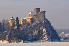 Medieaval castle in Niedzica in Poland in wintertime. Medieval stone defence castle on a hill in Niedzica in mountains in southern Poland during winter time royalty free stock photo