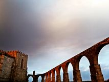Medieval abbey and aqueduct of Vila do Conde, Portugal, on a mis stock image
