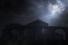 Medieval abbey in a full moon night Stock Image
