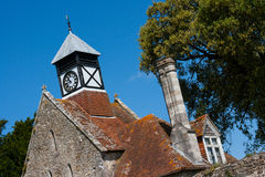 Medieval Abbey gate house and clock tower Royalty Free Stock Photos