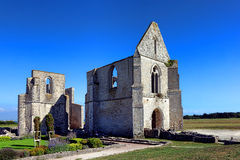 Medieval Abbey Gothic Church Ruins in France. Abandoned medieval abbey Gothic church ruins at the Abbaye Notre Dame or Chateliers antique monument on Ile de Re royalty free stock images