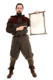 Medieval adventurer is holding a old scroll with copyspace Royalty Free Stock Photo