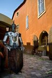 Medieval advertising - knight holding a blank sign stock photography