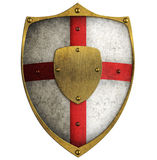 Medieval aged metal crusader shield isolated. Aged metal shield isolated on white Royalty Free Stock Image