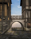 Medieval alley. A 3D rendered image of an arch and alley in a medieval village Royalty Free Stock Photo