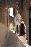 Medieval alley way. Old stone buildings and arched roof in medieval alley way Stock Images