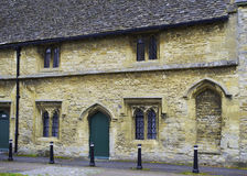 Medieval Almshouse in Burford. Burford, Oxfordshire, England – 23rd October 2015.  Medieval Almshouse on Church Green in Burford founded by Henry Bishop in Royalty Free Stock Photography