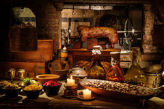 Medieval ancient kitchen tabe with typical food in royal castle.  Royalty Free Stock Photos