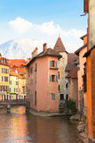 Medieval Annecy. View over a canal in the medieval town of Annecy, France with French Alpes in background Stock Photo