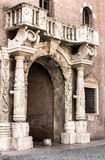 Medieval arch with a balcony in Verona. Medieval arch with a balcony in the historic centre of Verona.Italia Stock Image