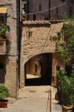 Medieval arch in Montone. Medieval arch with lamp in the historic center of Montone, a small town in the Umbria countryside in Italy stock images
