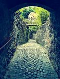 Medieval arch. Small medieval tunnel and steep Stock Photo