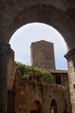 Medieval Arch Town San Gimignano Italy. Medieval Arch Stone Tower Medieval Town Pink Flowers San Gimignano Tuscany Italy Stock Photography