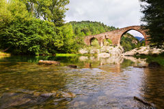 Medieval arched bridge over Llobregat river in  Pyrenees Stock Photography