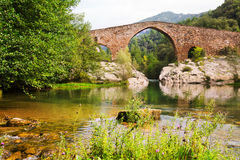 Medieval arched bridge over Llobregat river in  Pyrenees. Catalonia, Spain Royalty Free Stock Photo