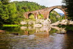 Medieval arched bridge   in  Pyrenees. Catalonia Royalty Free Stock Photos