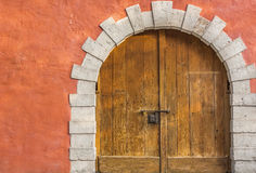 Medieval arched wooden door Stock Images
