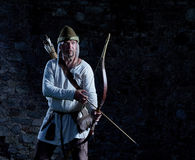 Medieval archer with a bow and arrows Stock Photography