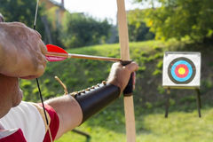 Medieval archer shoot at a target Stock Photography