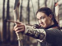 Medieval archery, woman shoot Stock Photo