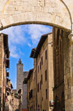 Medieval architecture of San Gimignano, towers and houses in narrow street, Tuscany Stock Image
