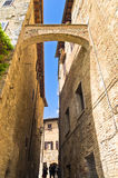 Medieval architecture of San Gimignano, towers and houses in narrow street, Tuscany Stock Images