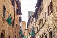 The medieval architectures of San Giminiano. San Giminiano, Italy, the medieval architectures of St. Matteo street Stock Images
