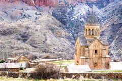 Medieval armenian Noravank monastery complex against red mountains, Armenia Stock Image