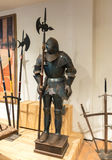 Medieval armor exposed with metal halberds. Royalty Free Stock Photography