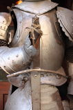 Medieval armor. Iron gauntlet and sword of a medieval armor Royalty Free Stock Photo