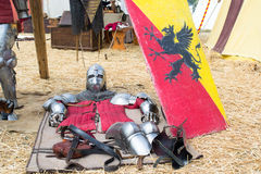 Medieval armor lying on the ground Stock Photo