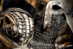 Medieval armor of metal helmet and glove Stock Photography