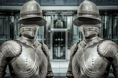 Medieval armor protecting a business building. Concept of firewa Stock Images