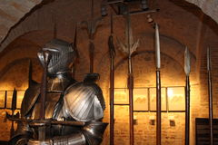 Medieval armor. With weapons in an old cellar Stock Image