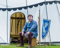 A medieval armorer sits outside his tent royalty free stock photos