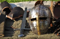 Medieval armour. Helmet, sword and other details of knight's uniform stock photo