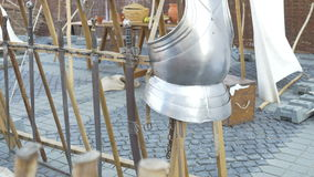 Medieval Armour. Shiny Middle Ages steel chest armour, mounted on a wood stand stock footage