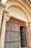 Medieval arquitrave and frieze over church door Royalty Free Stock Images