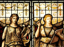 Medieval art. Detail of medieval stained glass depicting the muses of art and music Royalty Free Stock Photos