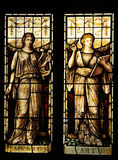 Medieval art. Medieval stained glass depicting the muses of art and music Royalty Free Stock Image