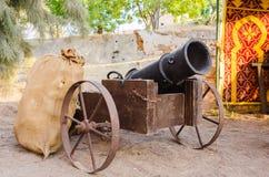 Medieval artillery canon. Old medieval artillery canon with ammunition bag Stock Photos