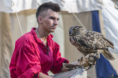 Medieval Arts Festival 2015 - Suceava Medieval Crown Fortress. Suceava, Romania - August 15th 2015 - Man with bird of prey at the Medieval Arts Festival held at Royalty Free Stock Images