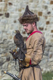 Medieval Arts Festival 2015 - Suceava Medieval Crown Fortress. Suceava, Romania - August 15th 2015 - Man dressed as a mongol with bird of prey at the Medieval Royalty Free Stock Photo