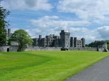 Medieval Ashford castle. Cong, Ireland - June 3, 2012: Medieval Ashford Castle is a medieval castle on the shores of Lough Royalty Free Stock Photography