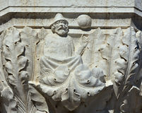 Medieval astrology in Venice. An astrologer point at the stars and planets. A medieval relief on Doge Palace outer portico in Venice royalty free stock photography