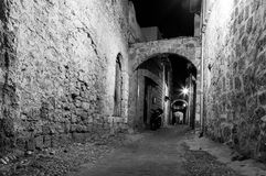 Medieval Avenue of the Knights at night, cobblestone street in Rhodes Citadel , Greece Stock Photos