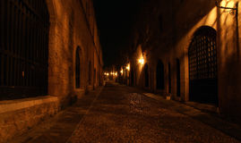 Medieval Avenue of the Knights at night, Rhodes. Medieval Avenue of the Knights at night, a cobblestone street in Rhodes Citadel , Greece Stock Images