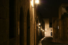 Medieval Avenue of the Knights at night, Rhodes. Medieval Avenue of the Knights at night, a cobblestone street in Rhodes Citadel , Greece Stock Photo